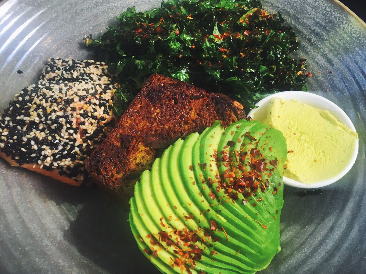 Trout, paleo bread, avo, and kale, from Bondi Wholefoods.