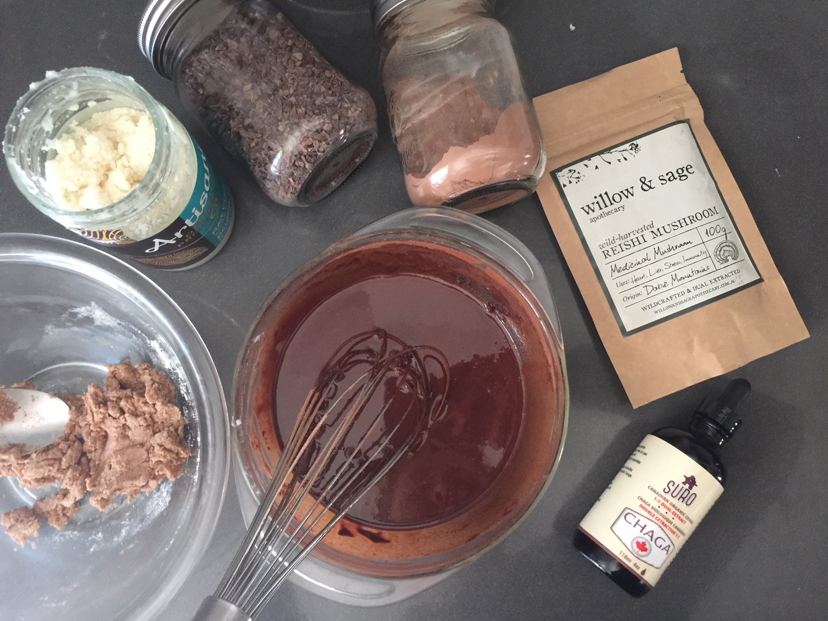Once the coconut oil/ butter and the cacao butter are melted, whisk in the collagen, cacao powder, collagen, and cinnamon.
