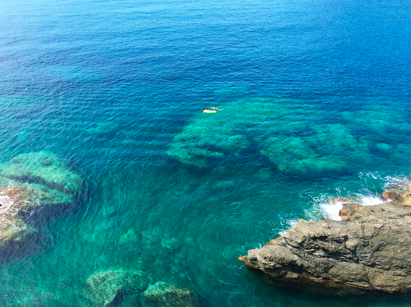 Swimming in the clear blue water in Cinque Terre, Italy.