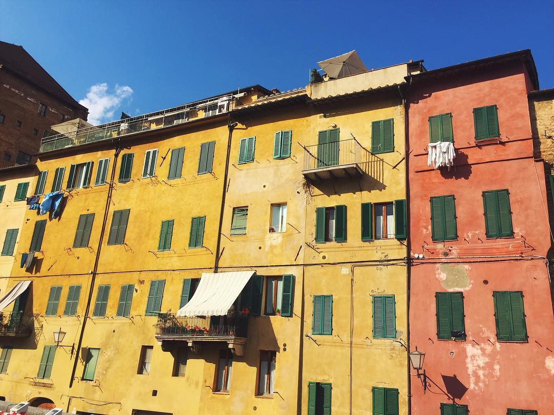 Afternoon sun shining on the houses inside the Old Town of Siena.