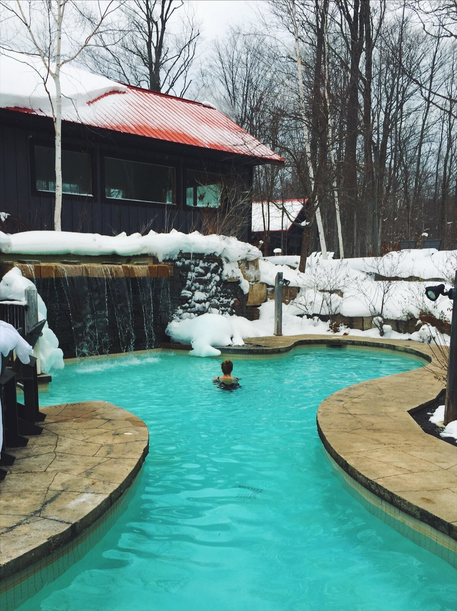 Taking a plunge in the cold pool (5 degrees celsius), in between sauna sessions at  Scandinave Spa , in Collingwood, Canada.