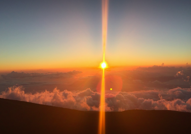 Sun setting 10,000 ft above sea level, from Haleakala volcano peak.