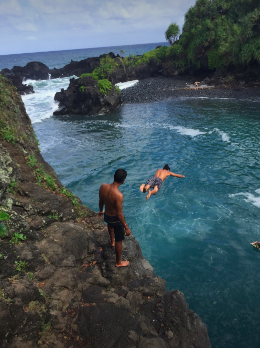 Arjun and Dan, cliff jumping on our day trip to Hana.