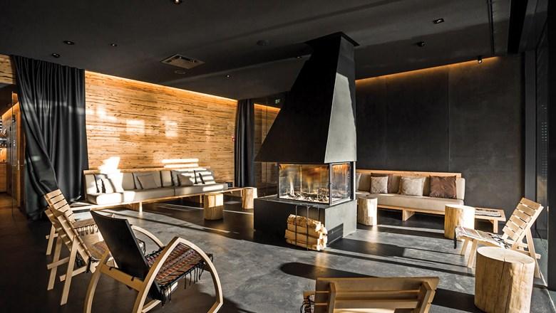 Fireplace/ lounge inside the sauna space. (Image: Löyly)