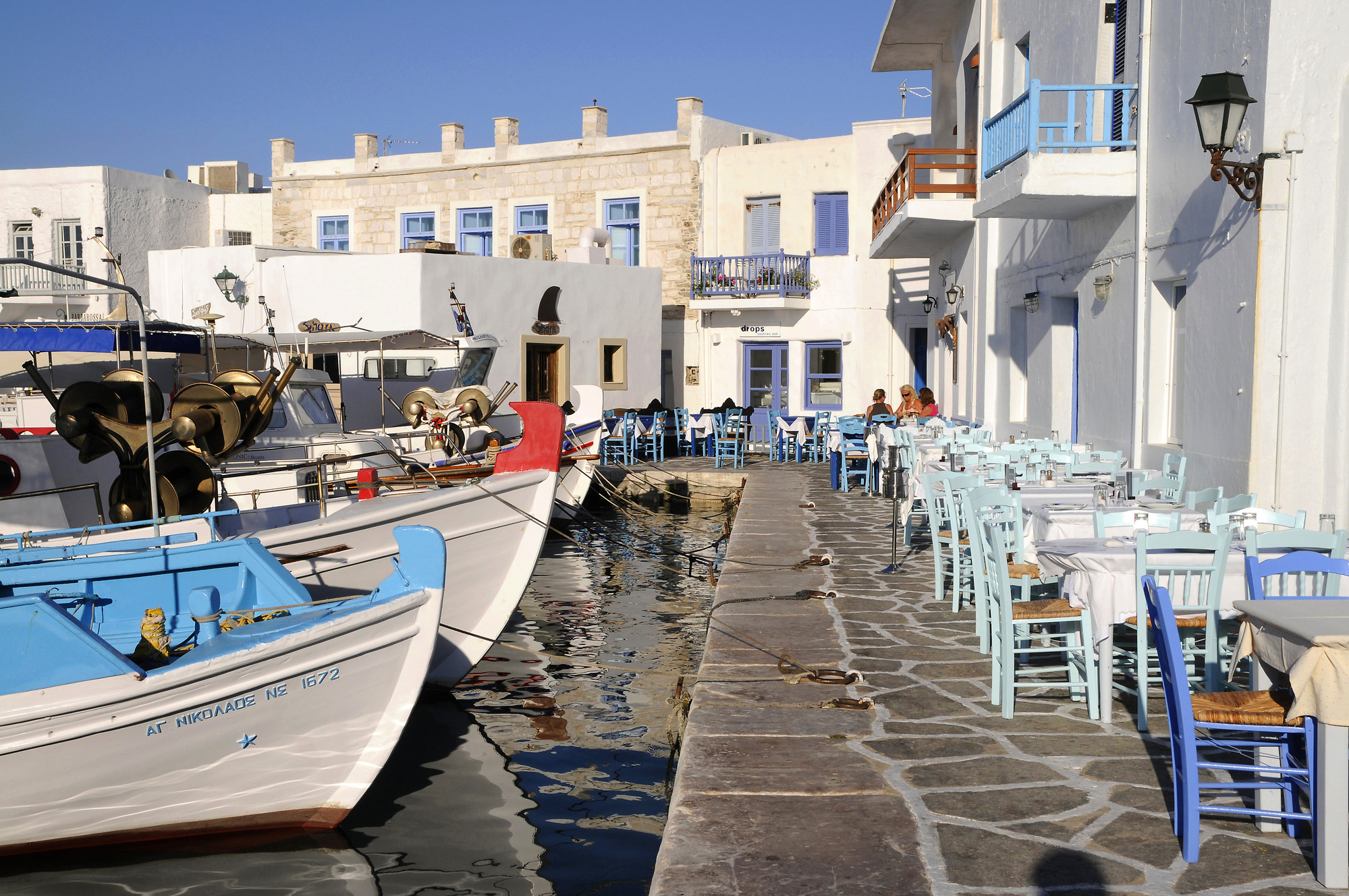 Naoussa harbour, filled with little cafés and outdoor seating.