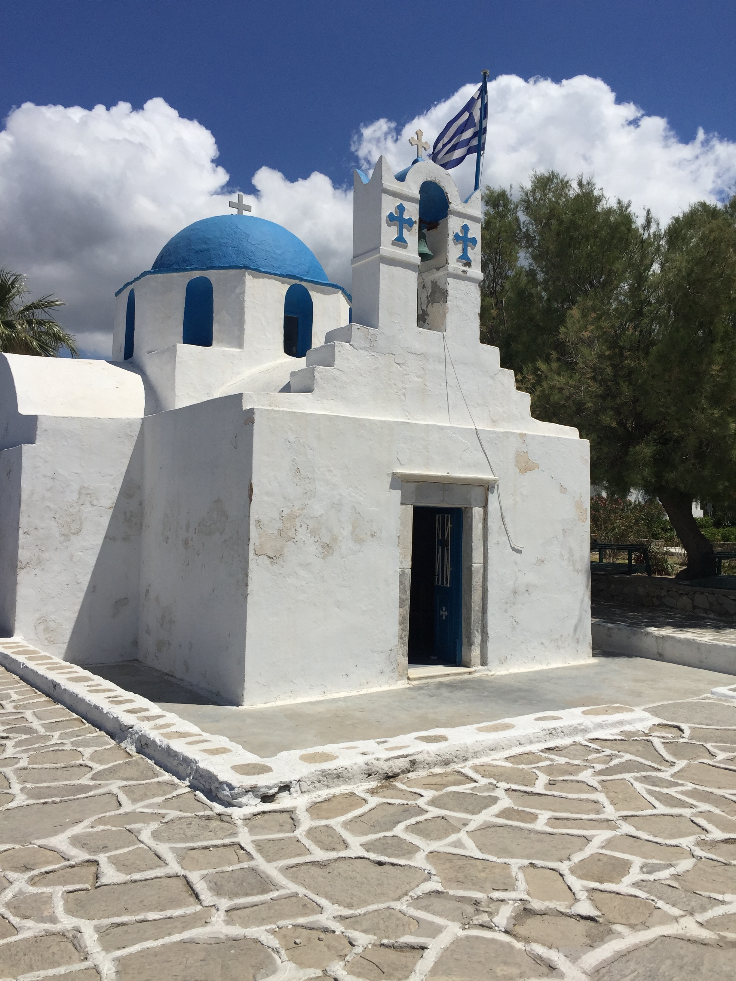 Agios Nikolaos church (the market is held to the left, along the trees).