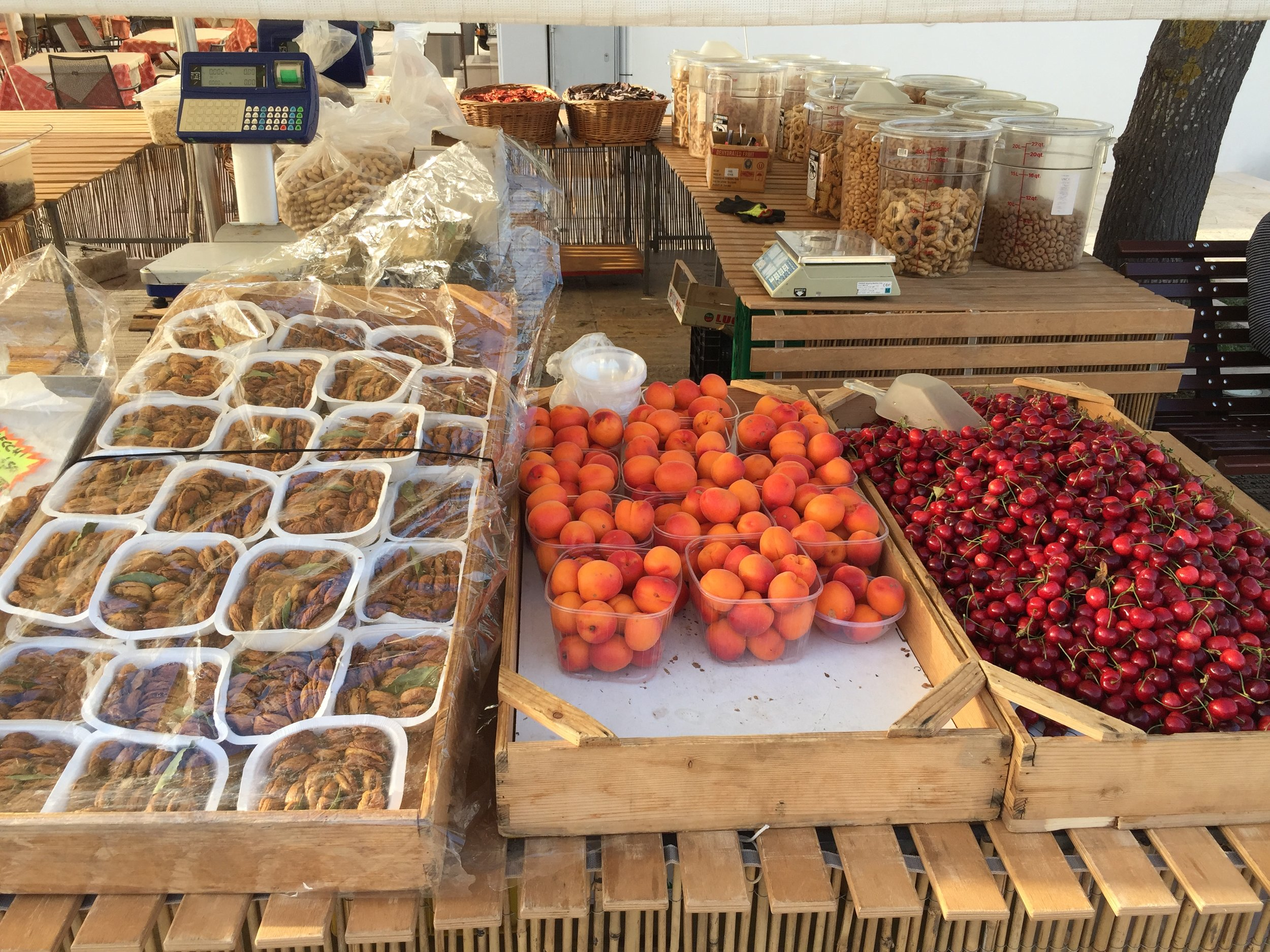 Fresh fruit and dried figs at the market stall in the heart of Alberobello.