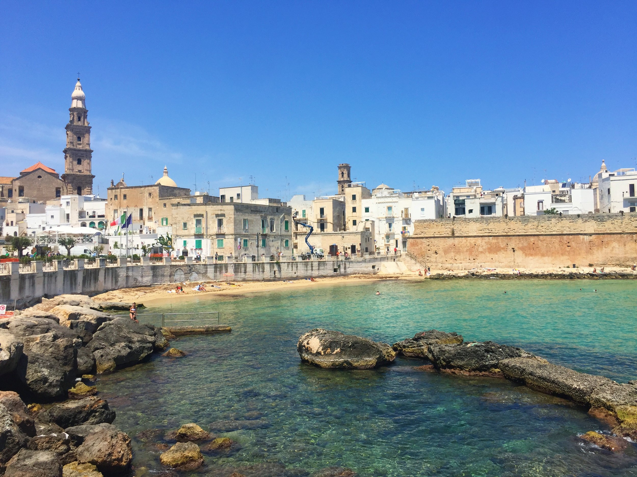 Views of Monopoli's old town from the boardwalk along the sea.