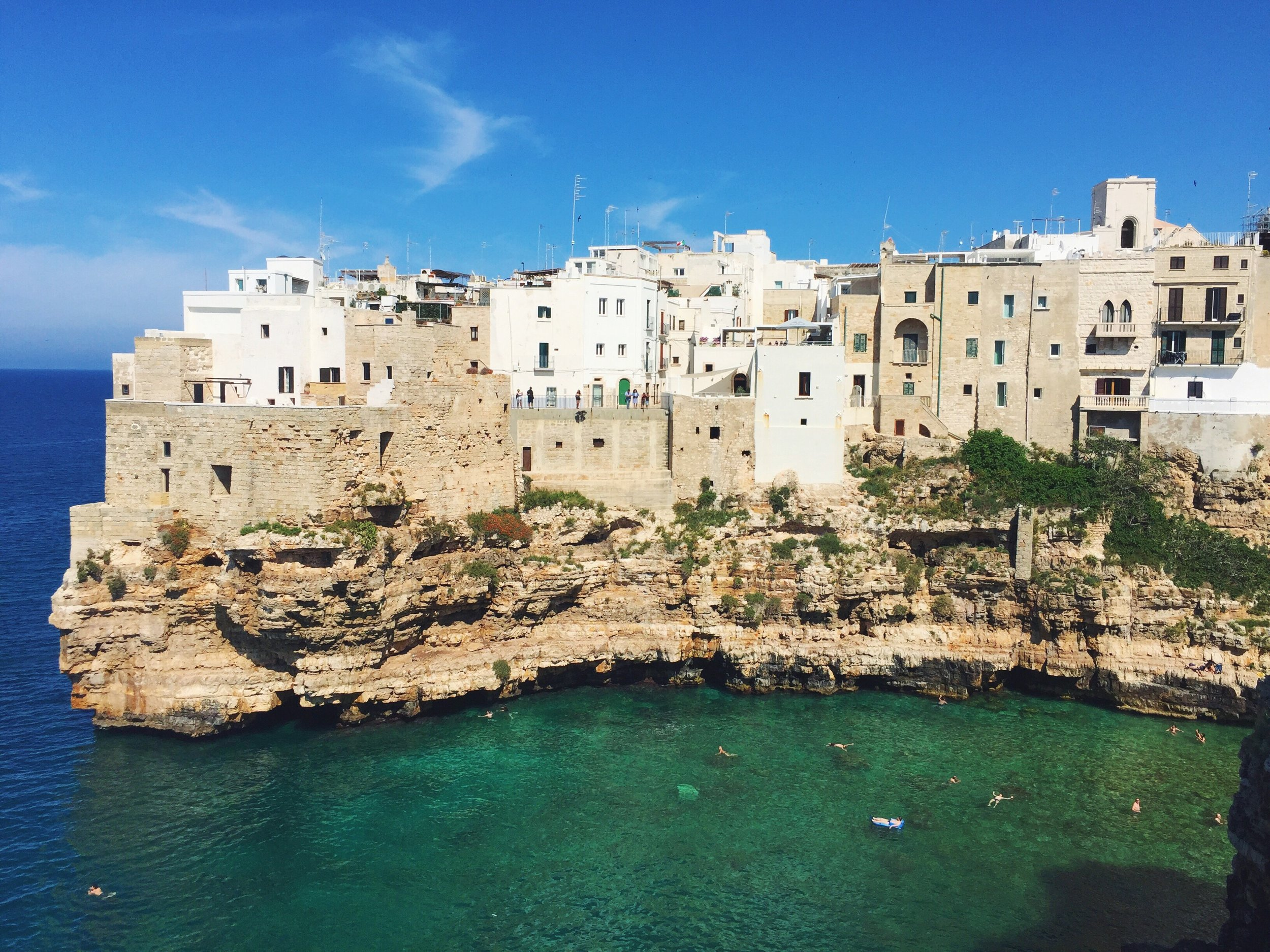Views of Polignano A Mare old town, and the opening to Lama Monachile beach