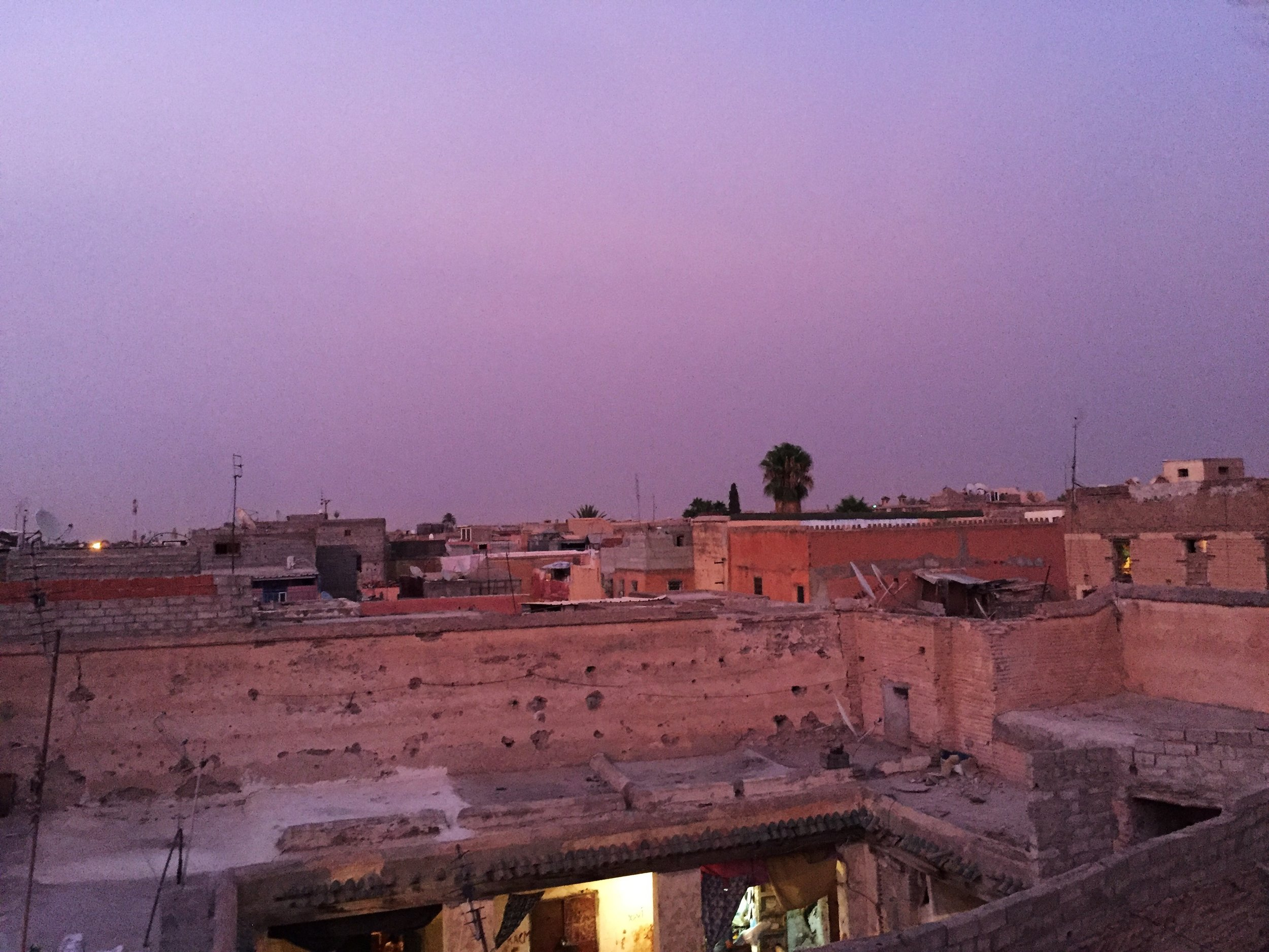 Pink sunset over Marrakech Medina— a perfect example that what can seem so peaceful and beautiful has a shadow lurking not too far below the surface.