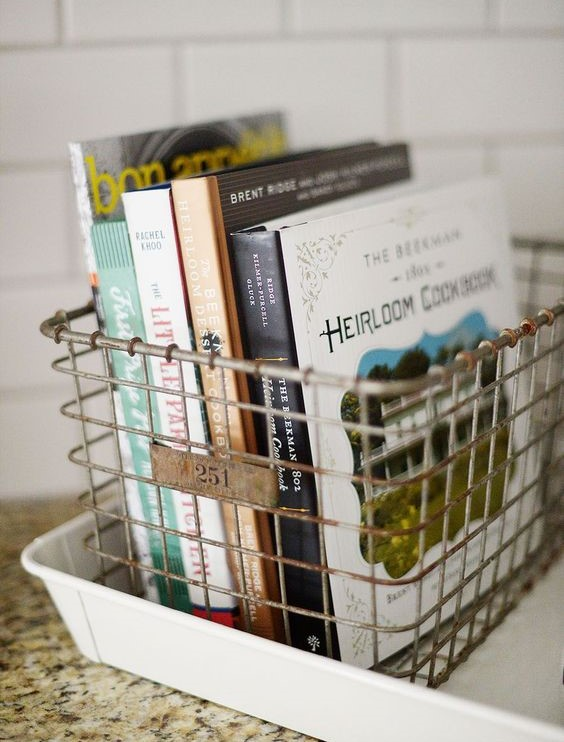 Cookbooks - Our rule of thumb when it comes to cookbooks is, never pass a good one up!They're a versatile decorating tool that's also functional. They make wonderful housewarming gifts as well!