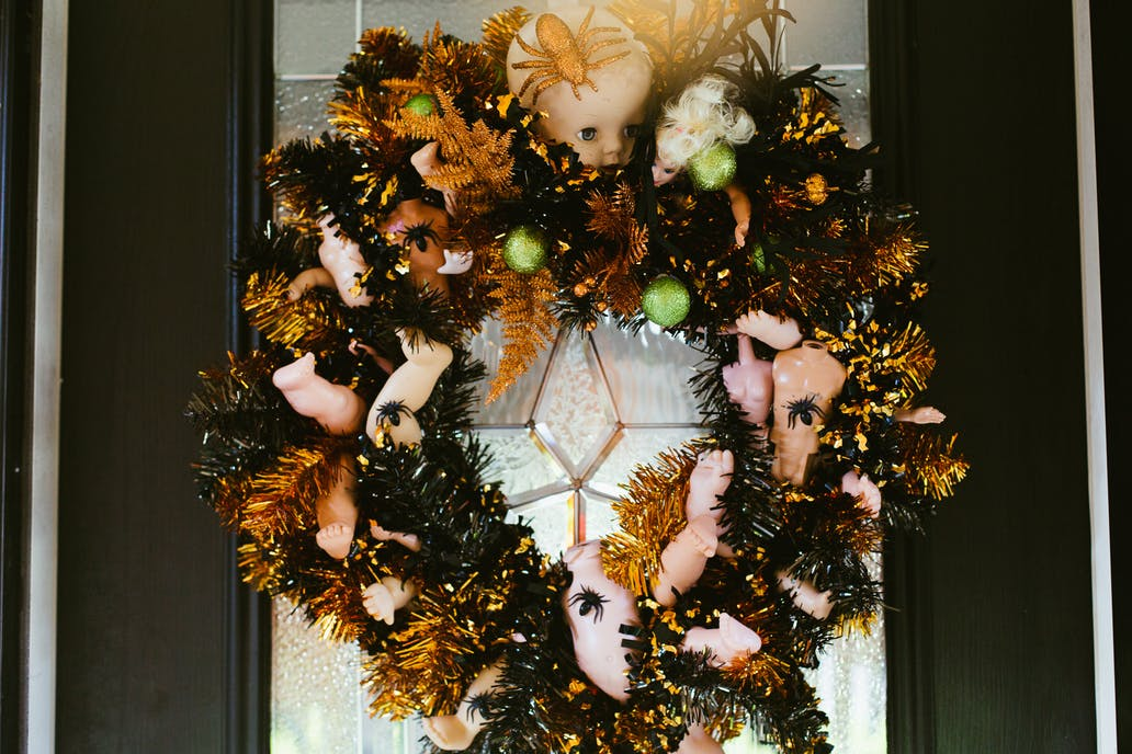 Dolls - We understand that dolls aren't for everyone, but this kitschy wreath is right up our alley! The vintage bottle wreaths stuffed full of vintage doll parts make our vintage-loving hearts happy.