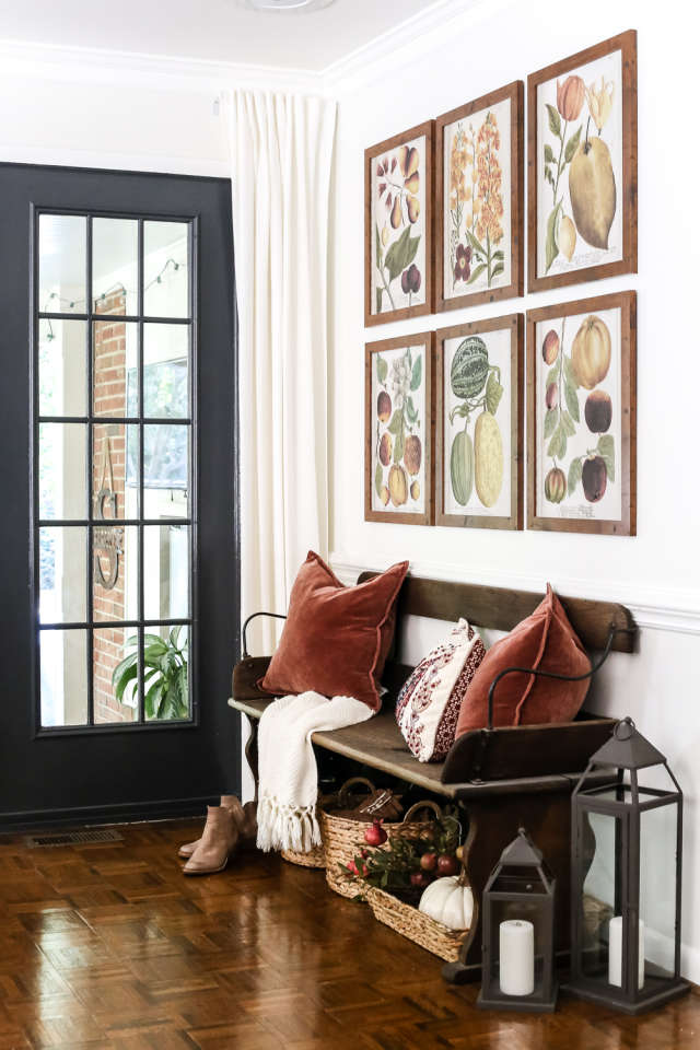 Entryways - Unfortunately, not all of us have a great front porch to showcase our fab fall decorations. But it is just as great to spill those ideas over into your entryway! Warm botanical prints + cozy pillows are a great option.