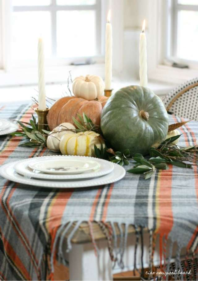 Table-scapes - Find yourself a vintage fall tablecloth - or in this case, a fabulous blanket - and bring it all together with fairy tale pumpkins and brass candlesticks.