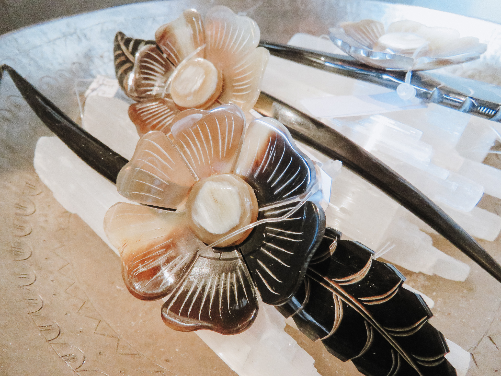 Accessorize - These carved horn hair pins are a fun accessory to give as a gift. A great option if you're on a budget!