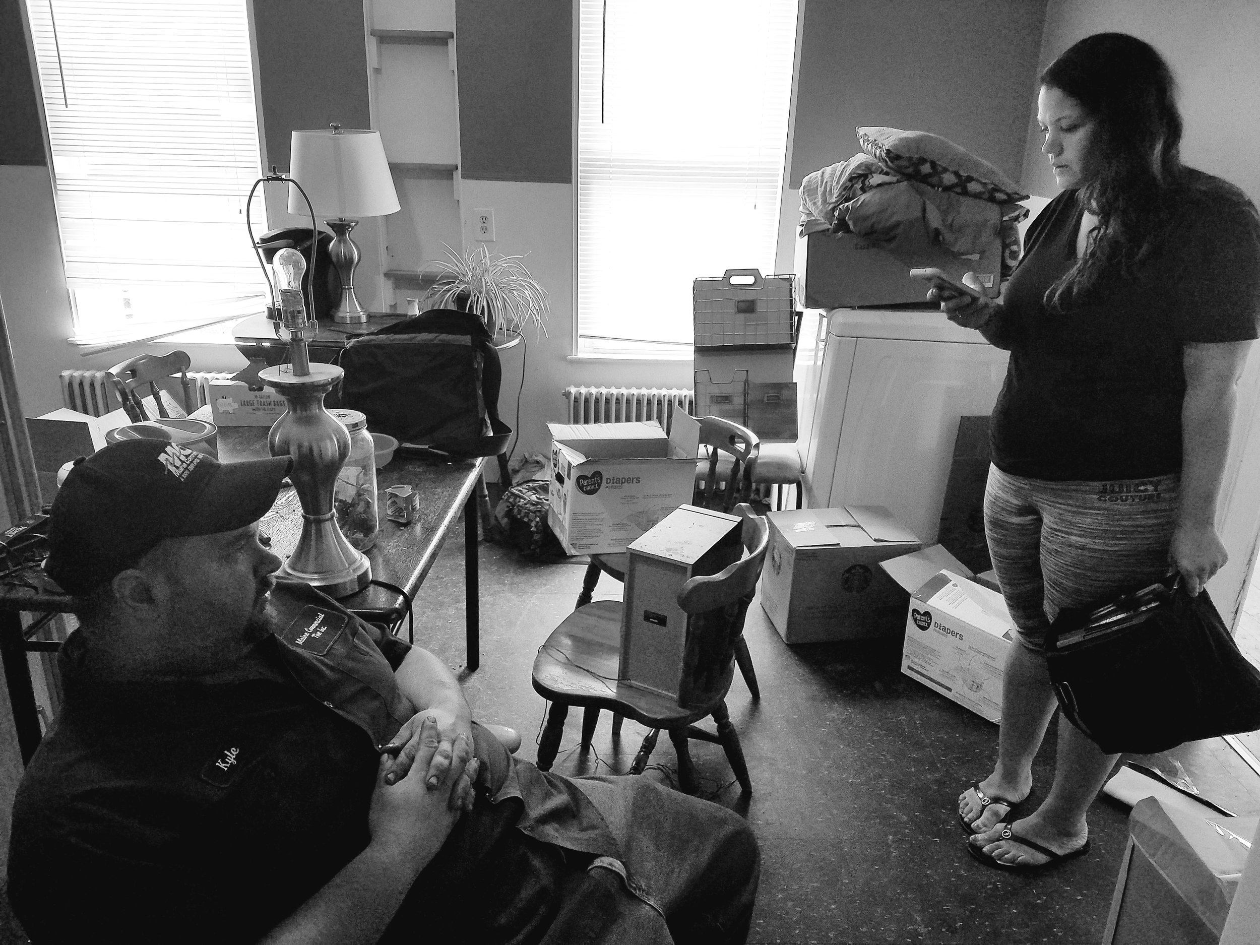 Joy and her boyfriend Kyle pack up her family's belongings. (Maine Public photo by Susan Sharon)