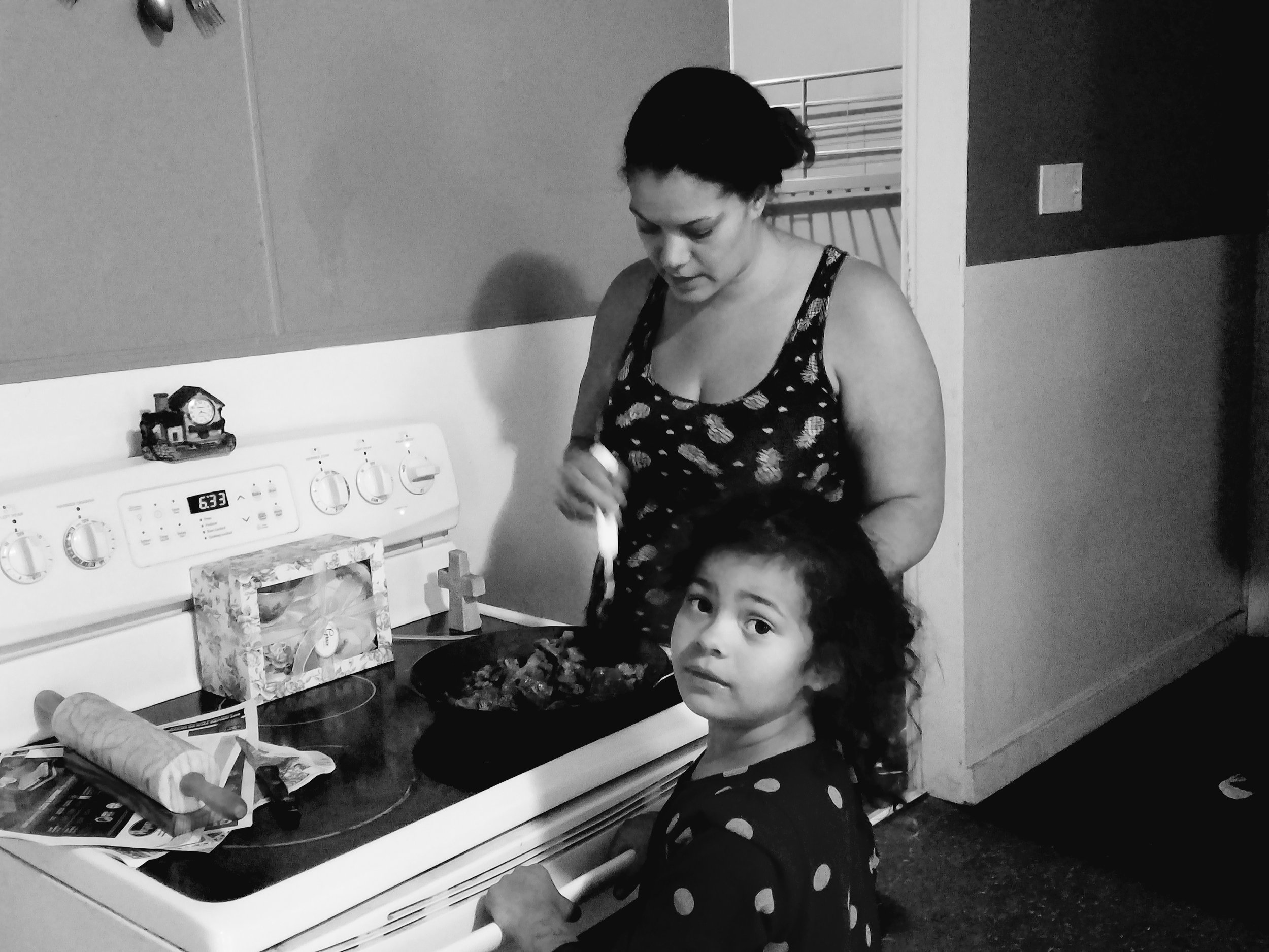 Joy cooks in the company of one of her three children. (Maine Public photo by Susan Sharon)