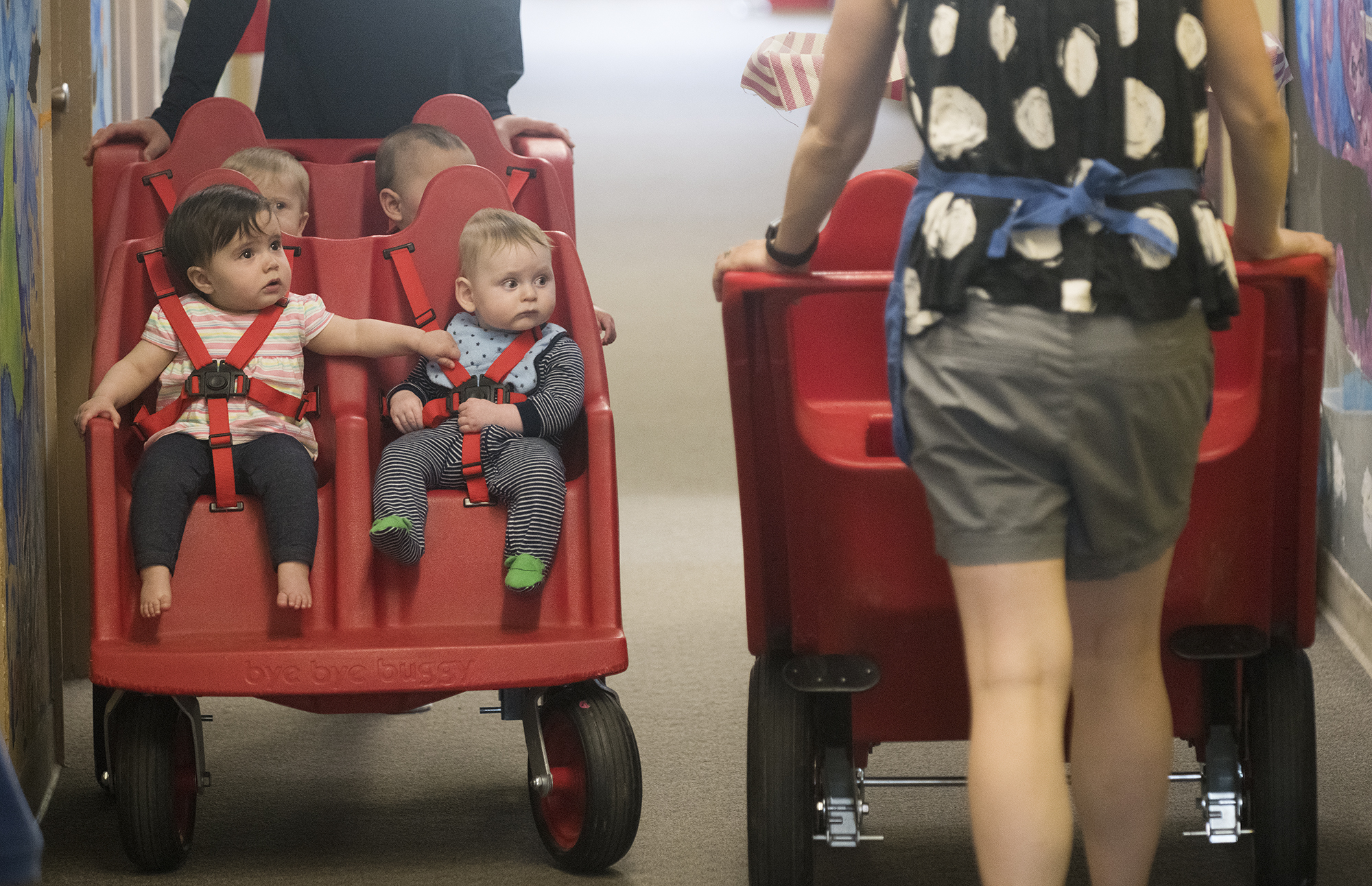 Children in buggies pass each other in the hall at Parkside Children's Learning Center in Bangor in June. (Kevin Bennett photo for Maine Public)