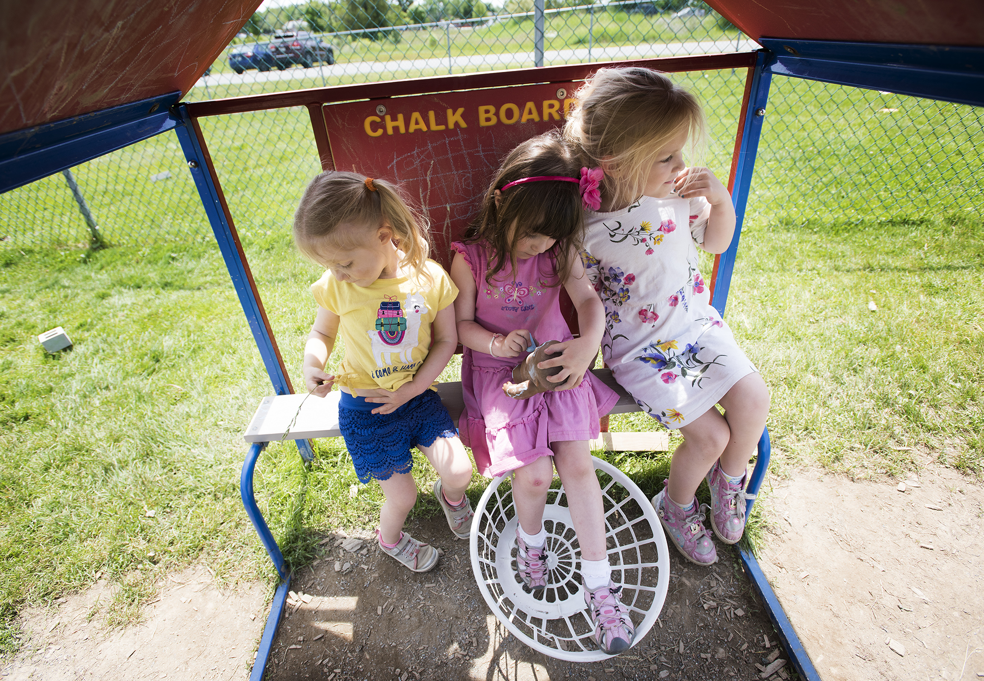 Children play outside at Parkside Children's Learning Center in Bangor in June. (Kevin Bennett photo for Maine Public)