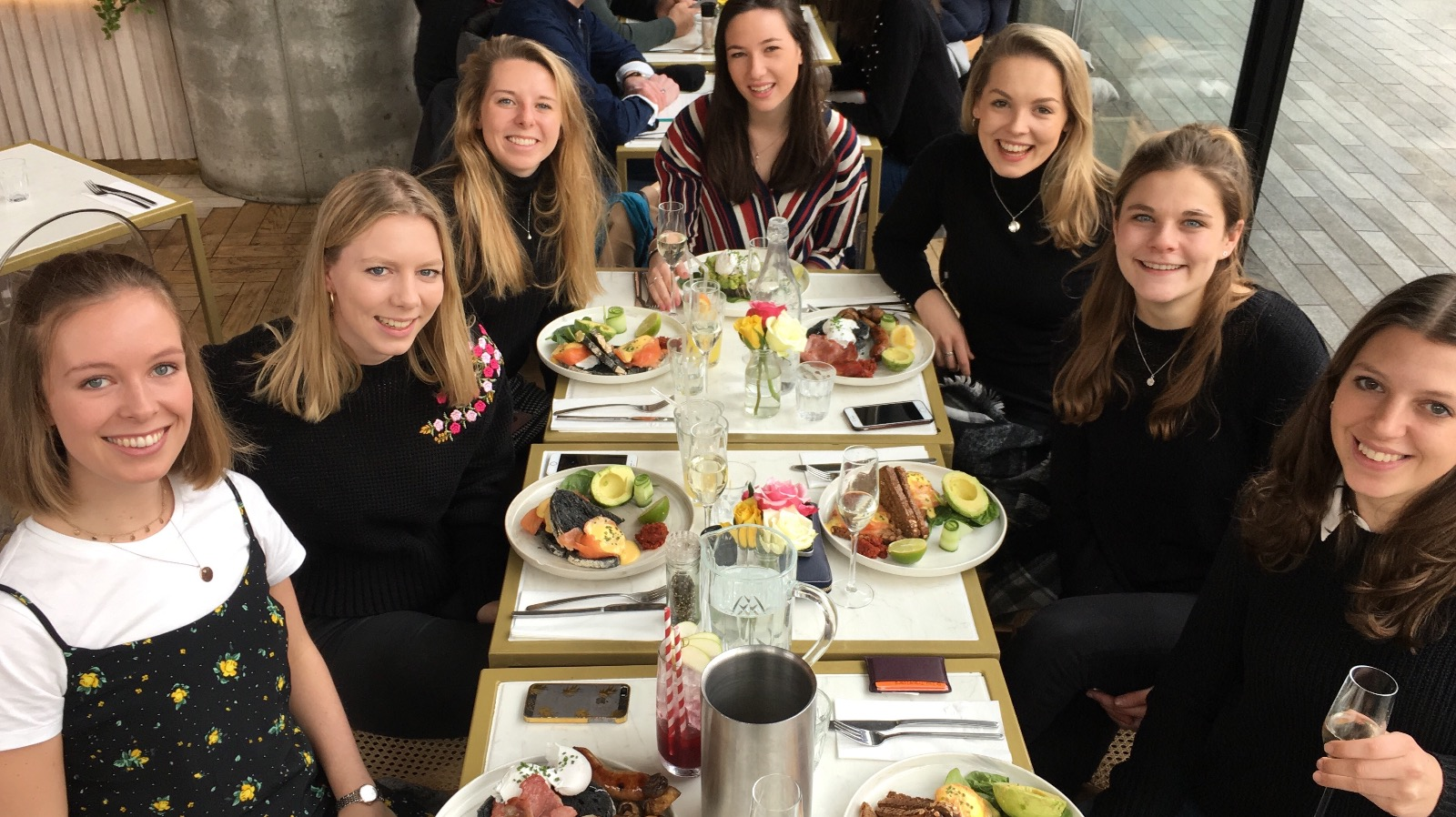 """Flora Munro, pictured here (third from right) enjoying """"avo on toast"""" with friends, is saving"""