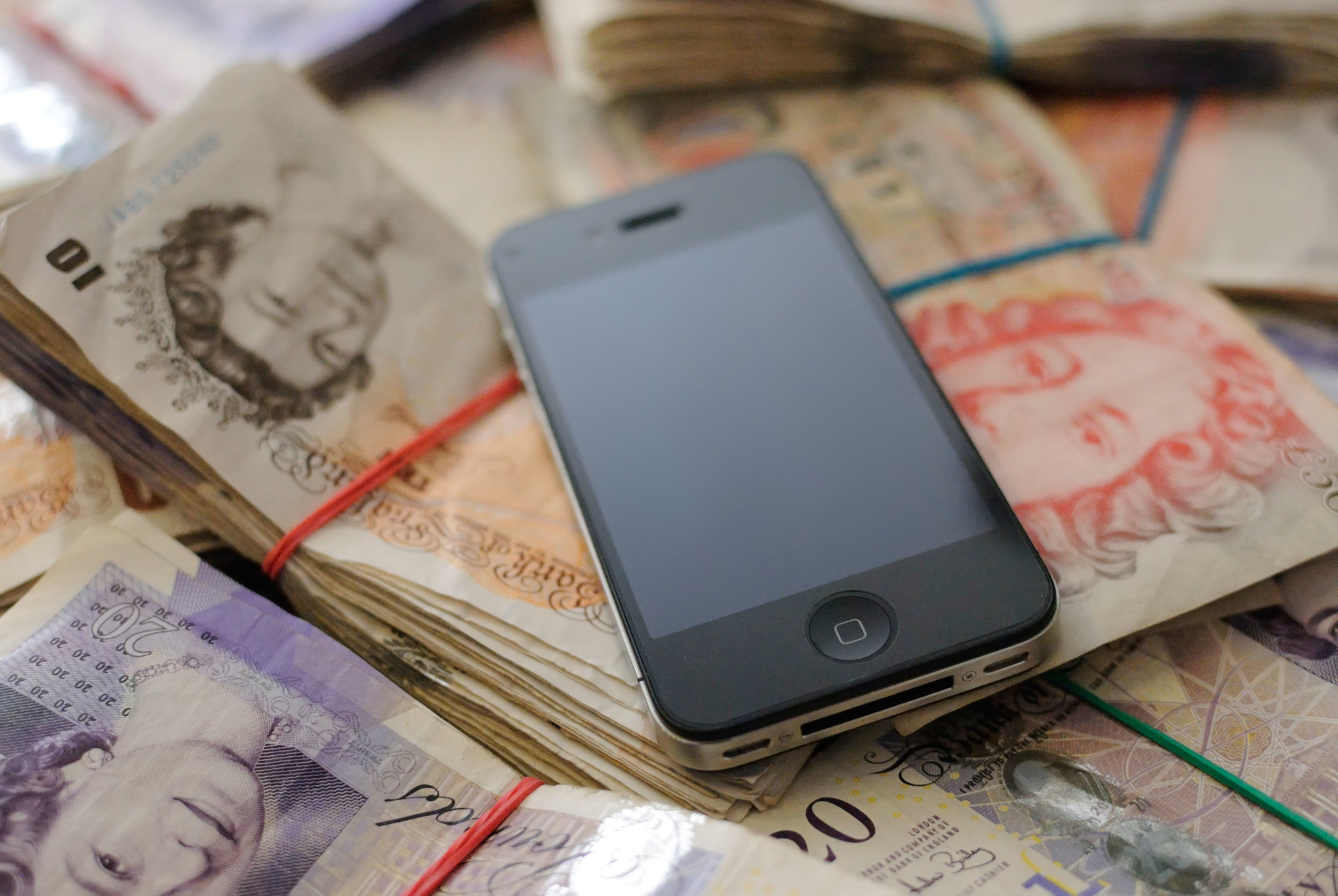 Natasha manages her finances using the Yolt app on her phone