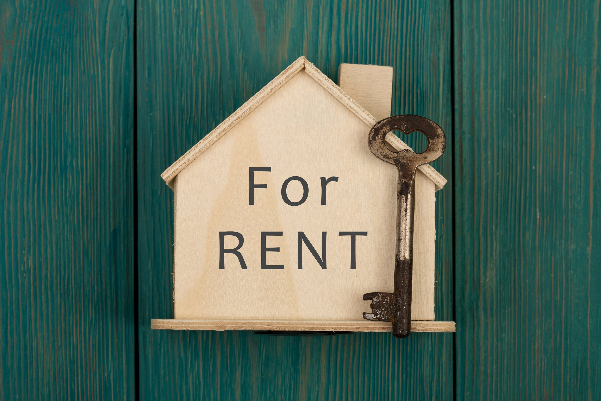 Little house with text For rent and key.jpg