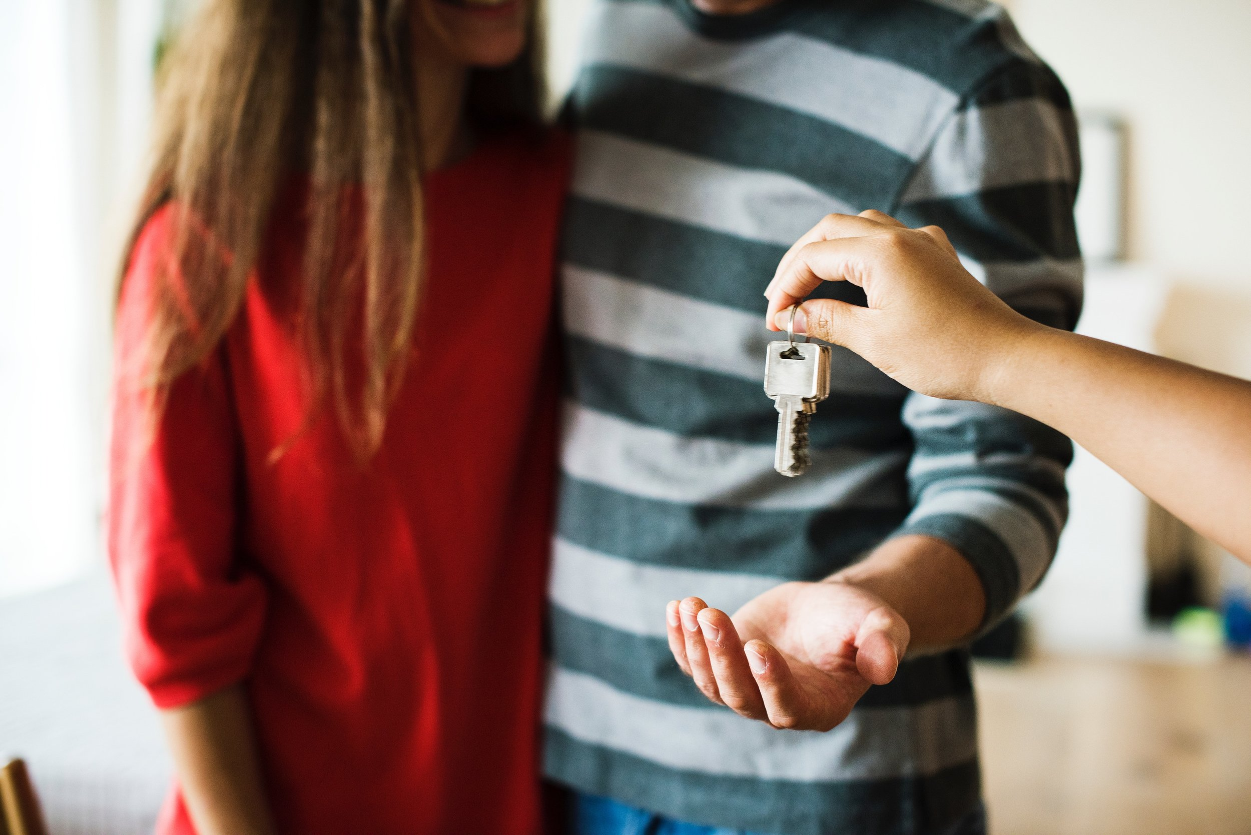 Couple getting keys to their home