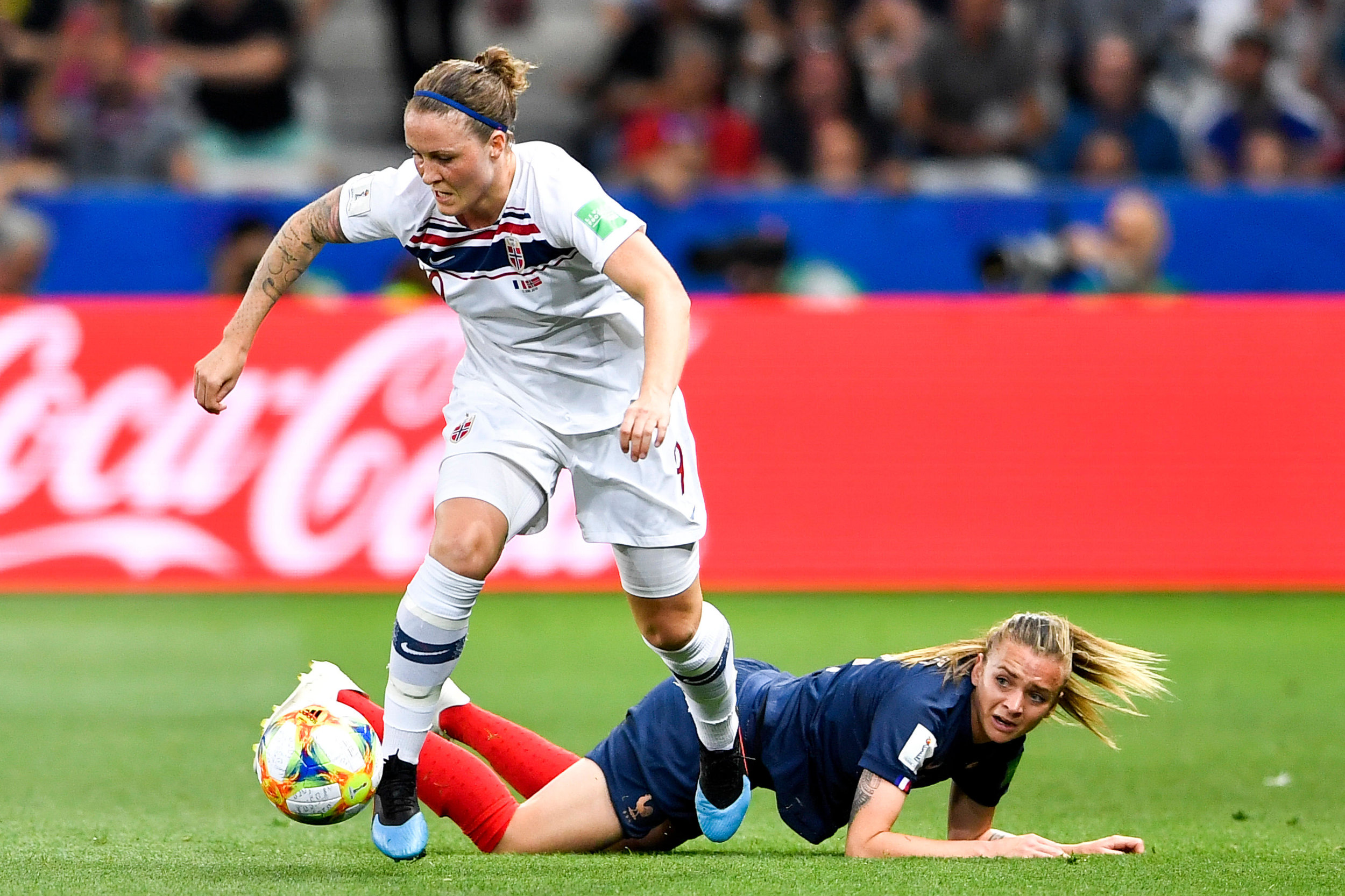 Isabell Herlovsen (L) of Norway view with Marion Torrent of France during the group A match between France and Norway at the 2019 FIFA Women's World Cup in Nice, France on June 12, 2019.