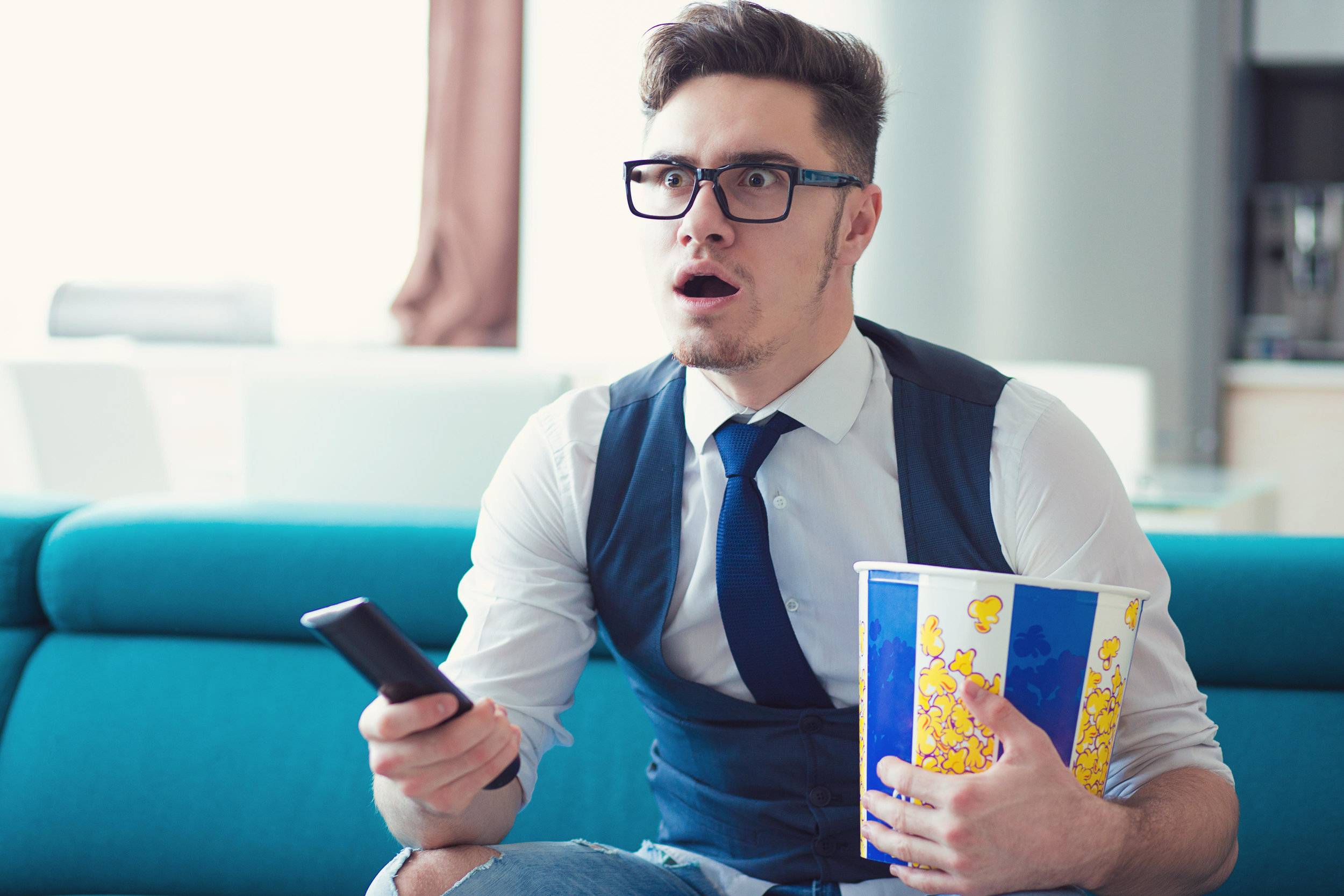 Man watching TV with popcorn
