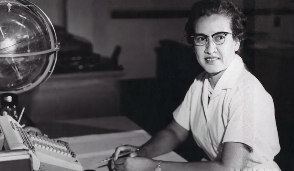 """Katherine Johnson at her desk at Langley with a """"celestial training device."""" Credit:NASA"""
