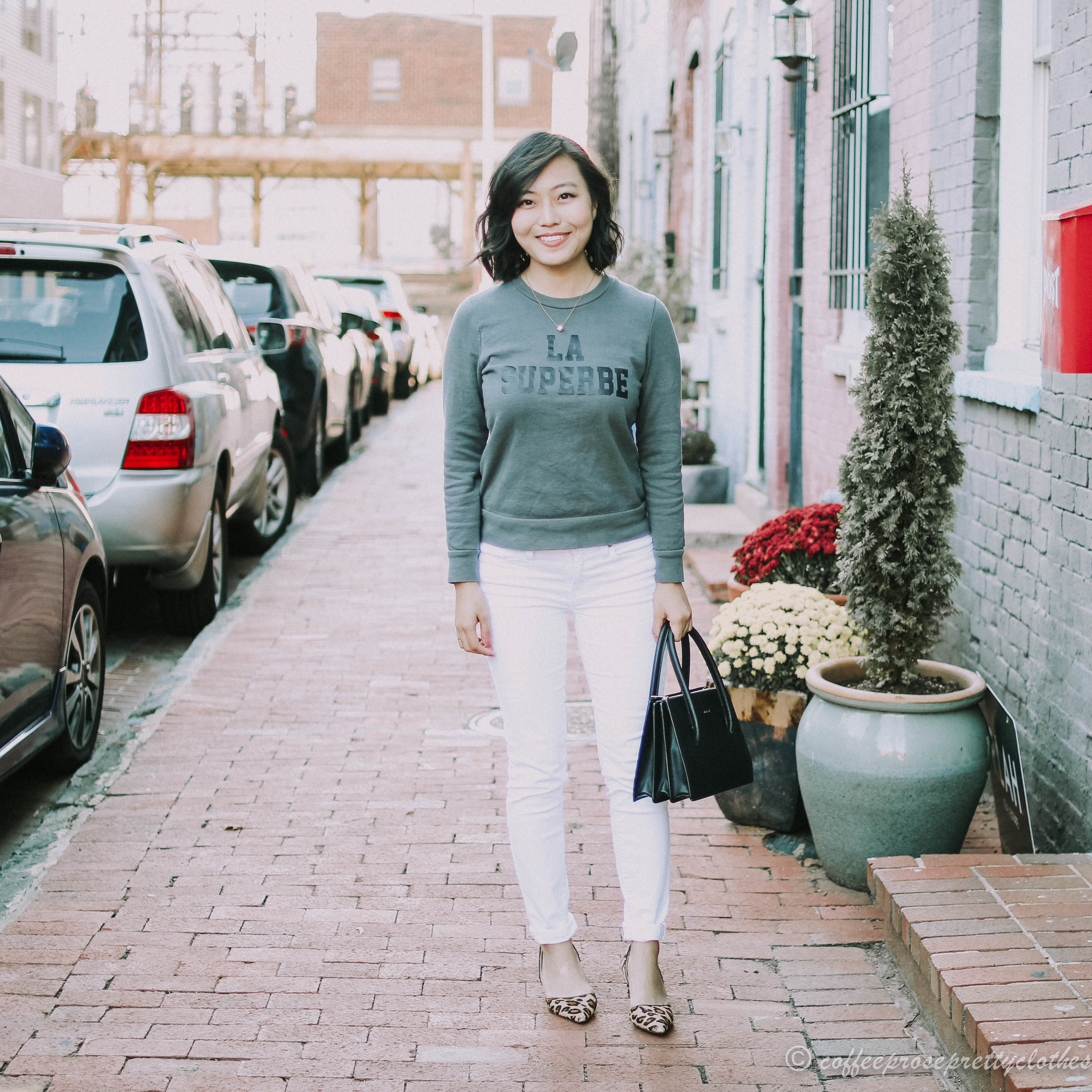 Sezane La Superbe Sweater and J.Crew white toothpick jeans, Angela Roi Eleanor Satchel, Sole Society Jenn Leopard heels