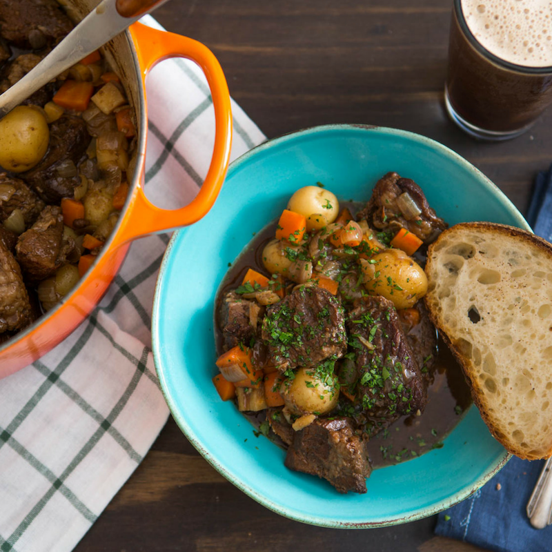 Guinness Beef Stew with Potatoes - Add chicken stock to a bowl. Sprinkle gelatin evenly all over surface. Season beef with salt and pepper, and add to Dutch oven. Cook for 10 minutes and remove. Add split carrots, split parsnip, halved onions, and garlic to oven. Add stock, gelatin, coffee, chocolate, Guinness, bouquet garnis, fish sauce, soy sauce, and Worcestershire sauce. Add beef to oven and cook for 1 hour. Add reserved veggies and cook 45 minutes more.Get the Recipe
