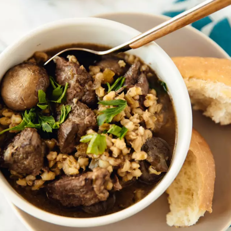 Slow-Cooker Beef and Barley Stew - Season beef with salt and pepper. Add a single layer of meat to the bottom of the pan, and sear for 2-3 minutes. Place beef in the slow cooker. Cook onions, mushrooms, celery, garlic, thyme, and bay leaf in the pan. Add wine and cook until absorbed. Transfer everything to the slow cooker, cover, and cook for 4 hours on low. Stir in barley and cook 2 more hours. Delicious!Get the Recipe