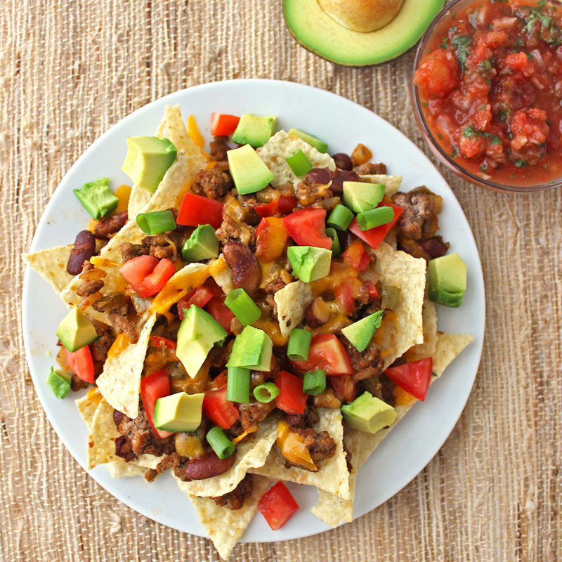 Healthier Loaded Nachos - Quick, tasty, and healthy? That's right, this recipe is savoury without the added calories. These delicious nachos contain seasoned ground beef, beans, onions, and bell peppers. Gooey cheese, tomatoes, avocados, and jalapenos top off this mouth-watering dish!Get the Recipe