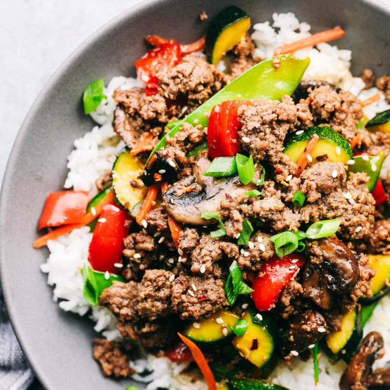 Korean Ground Beef Stir Fry - A veggie-packed meal paired with lean ground beef? Sign us up! Top seasoned ground beef with bell peppers, zucchini, snap peas, carrots, and mushrooms! Next, a tasty sauce compliments the dish. Mix brown sugar, soy sauce, sesame oil, ginger, red pepper flakes, and pepper. This recipe's tangy flavour will leave you wanting more!Get the Recipe