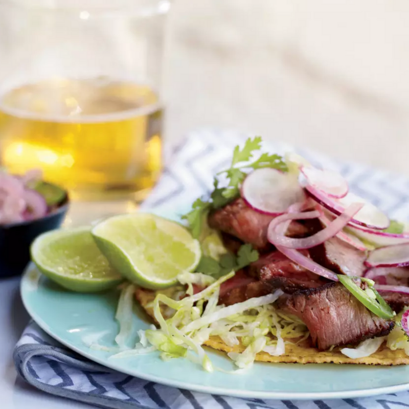 Grilled T-Bone Tostadas with Spicy Radish Salad - This dish is spicy and savoury. Everyone will be complimenting the chef at your next soiree! Toss spice-rubbed T-bone steaks with radishes, jalapeno, lime juice, tostada shells, and iceberg lettuce. The perfect healthy holiday treat!Get the Recipe