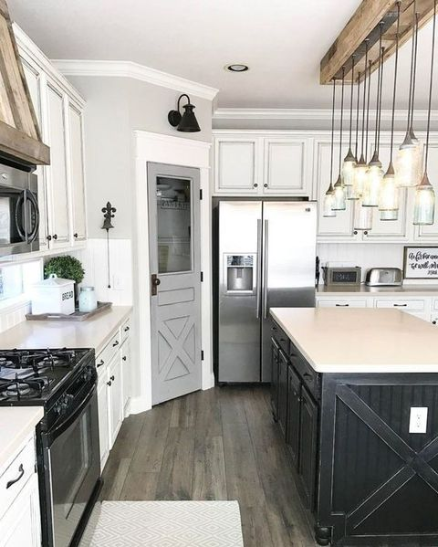 1. Rustic & Warm  - We love the rustic yet contemporary take on this kitchen-- and the details along the pantry door and the counters!