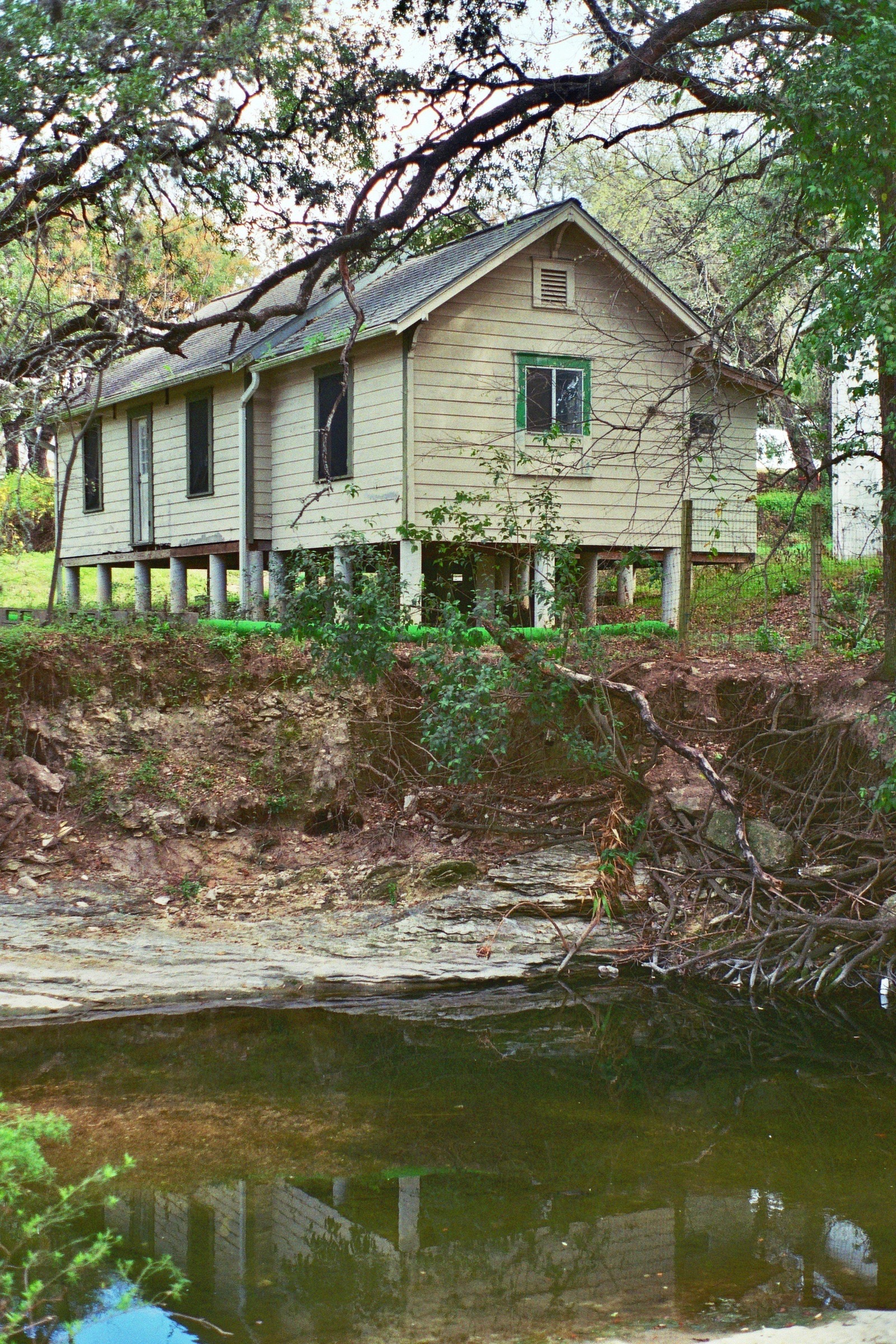 A home stands proudly above Bouldin Creek.  Austin, TX