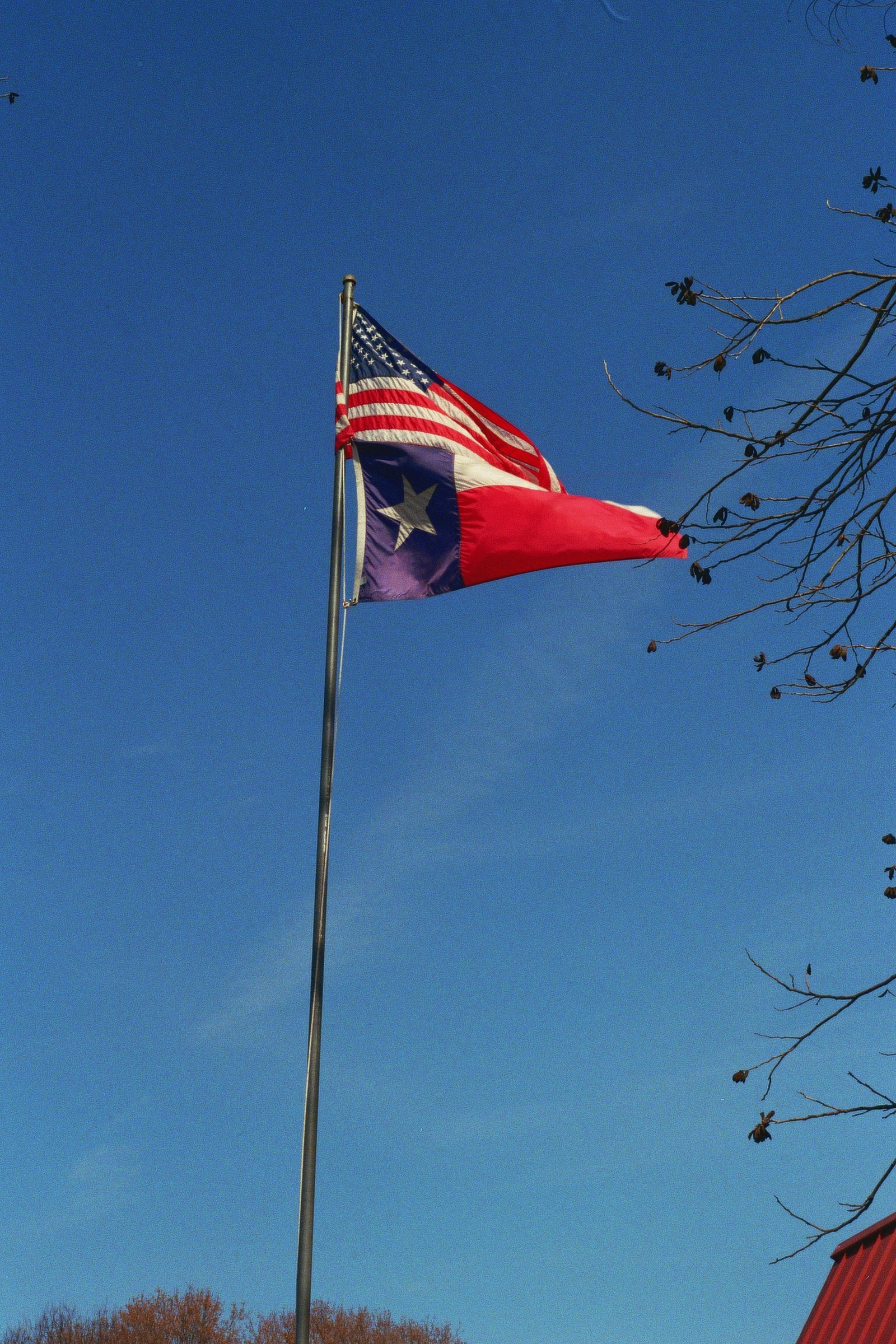 The Texan flag. Quite possibly flown with more frequency and pride than any other state flag in America, and rightly so.  Austin, TX