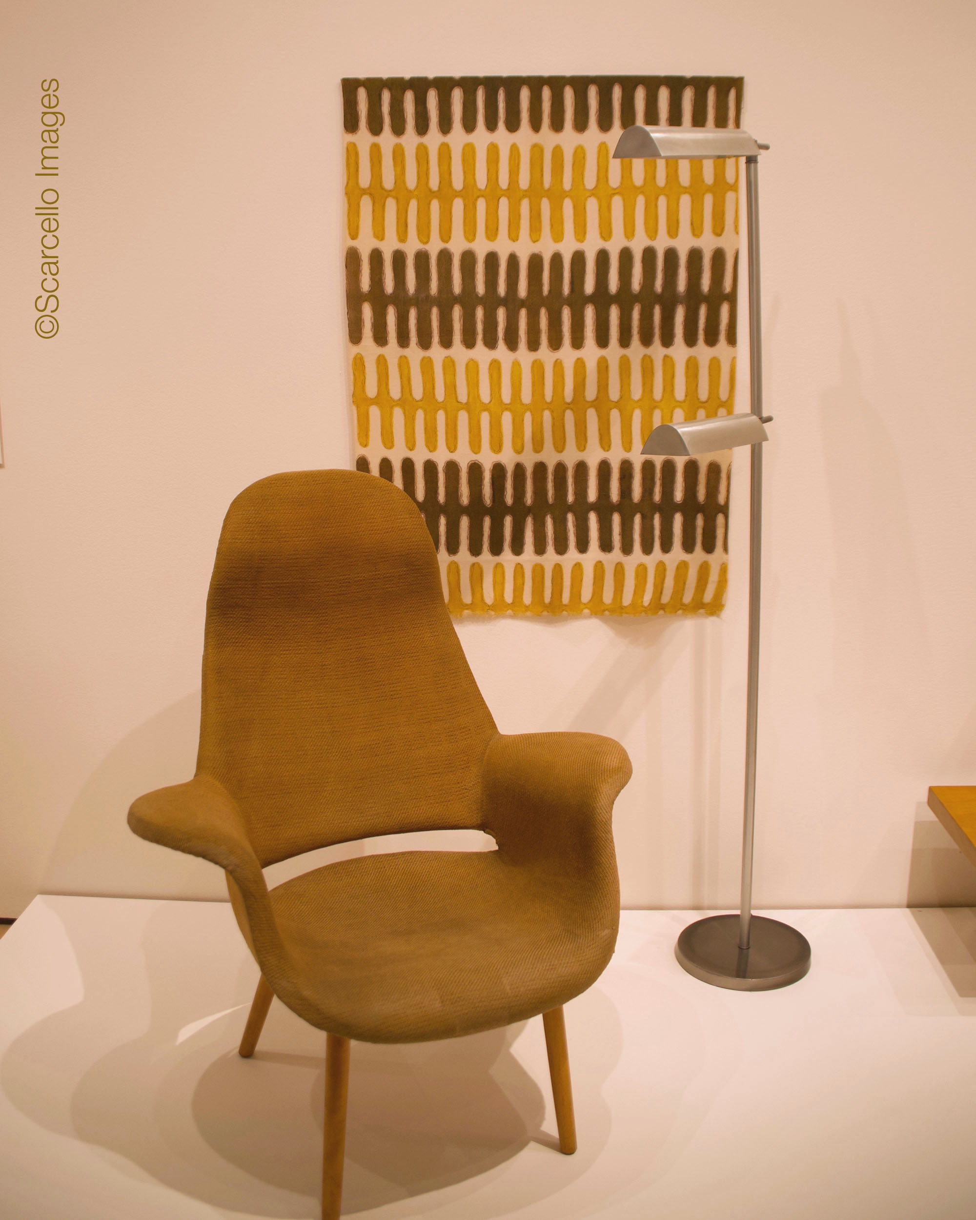 Arm chair by Eero Saarinen and Charles Eames. Hanging fabric by Virginia Nepodal. Lamp by Peter Pfisterer. All 1940.
