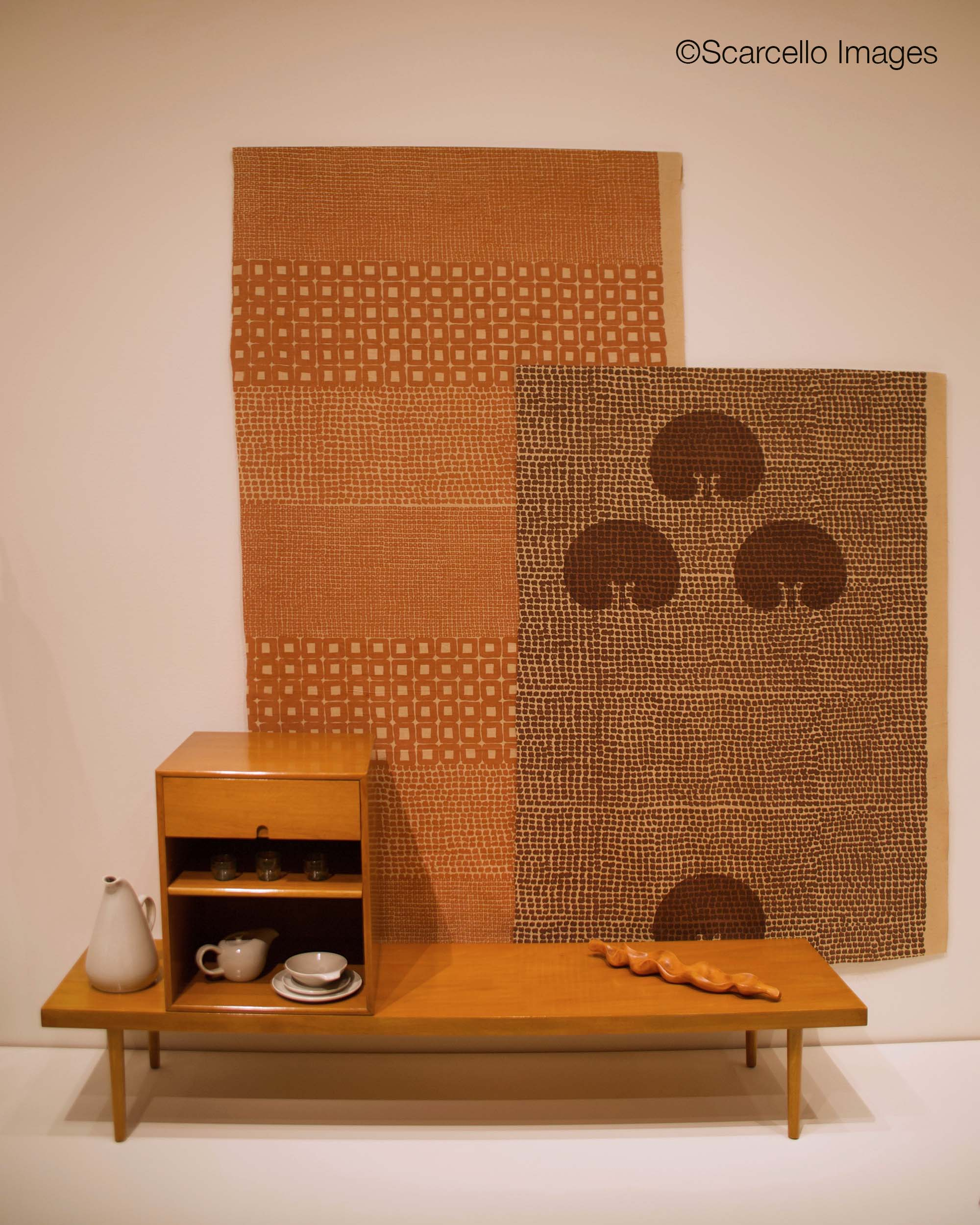 Bench and cabinet by Charles Eames and Eero Saarinen. Fabrics by Noémi Raymond. All 1940.