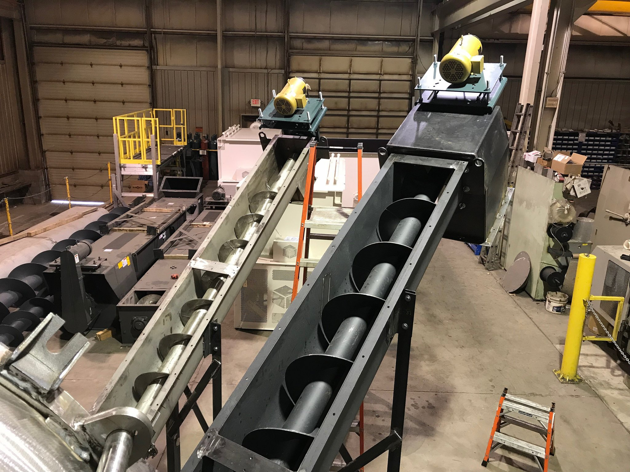WASTE PACKAGING CONVEYOR-SCREW CONVEYOR  Our waste conveyors come in 12', 16', 20', & 24' lengths - standard. We can also provide custom screw lengths to fit in your facility; through walls, out to docks, etc. All our units have removable covers, Dodge bearings, Dodge gear boxes, and Baldor motors. Available in carbon steel [std.] and 304SS