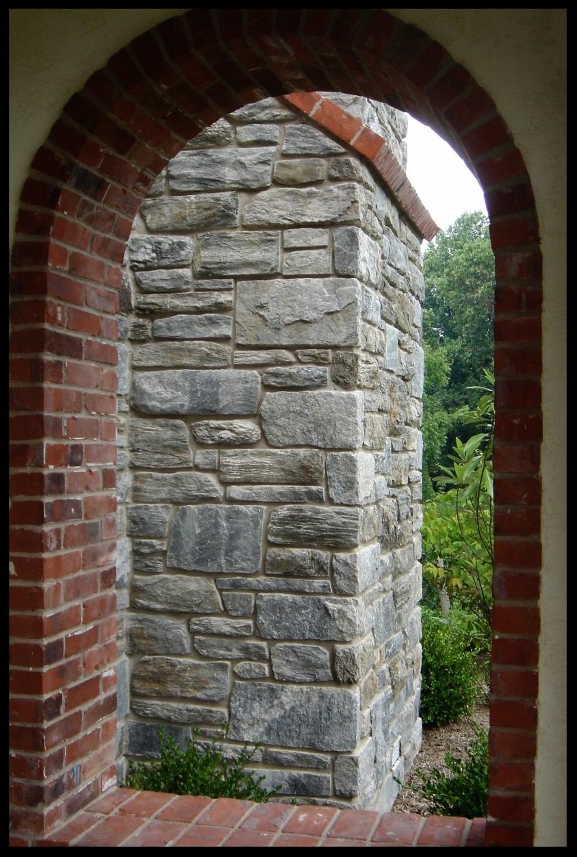 Brick Window with Stone Chimney.JPG