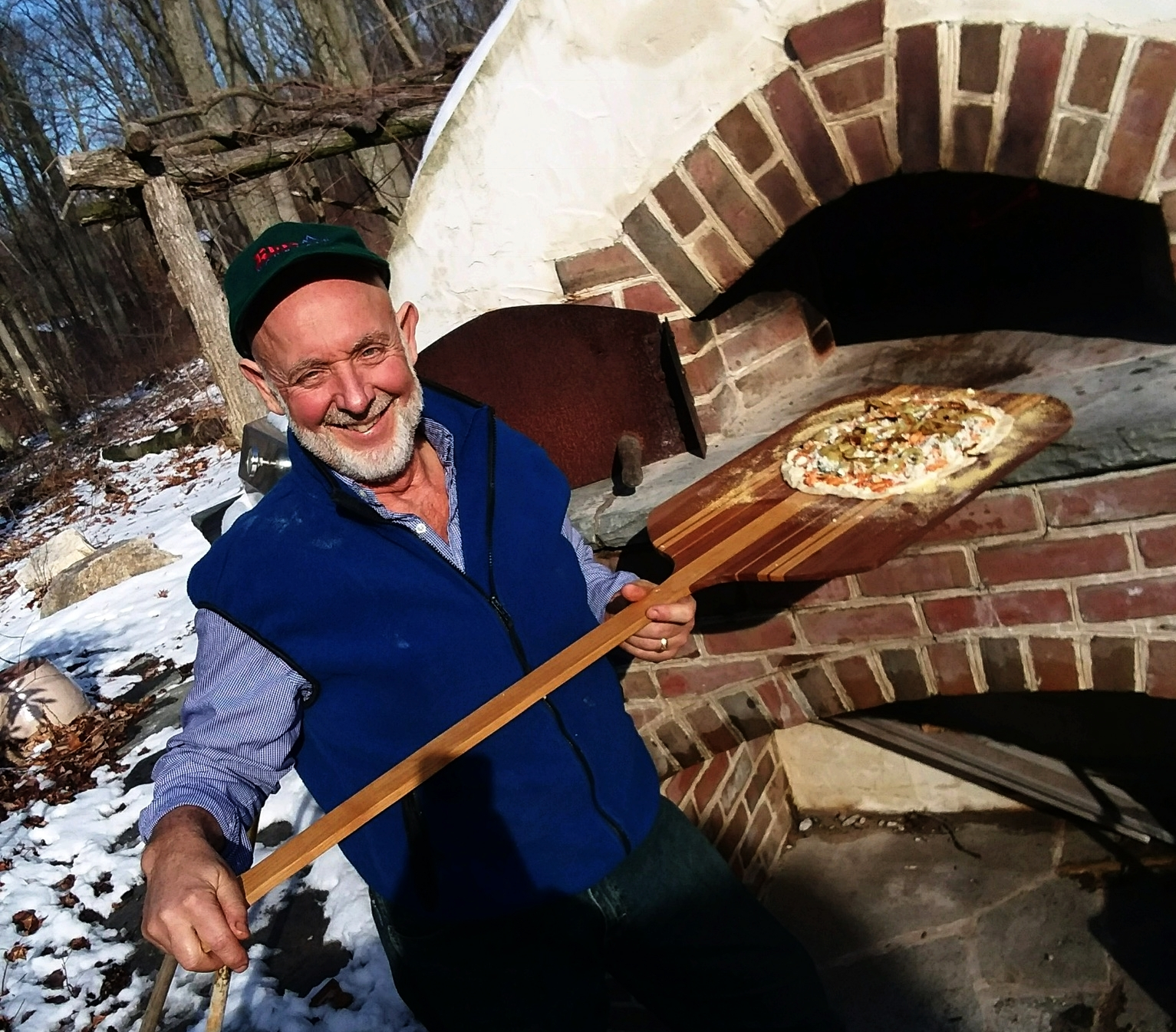 The owner and operator, Eli Smucker, enjoying his wood fired pizza oven at home.