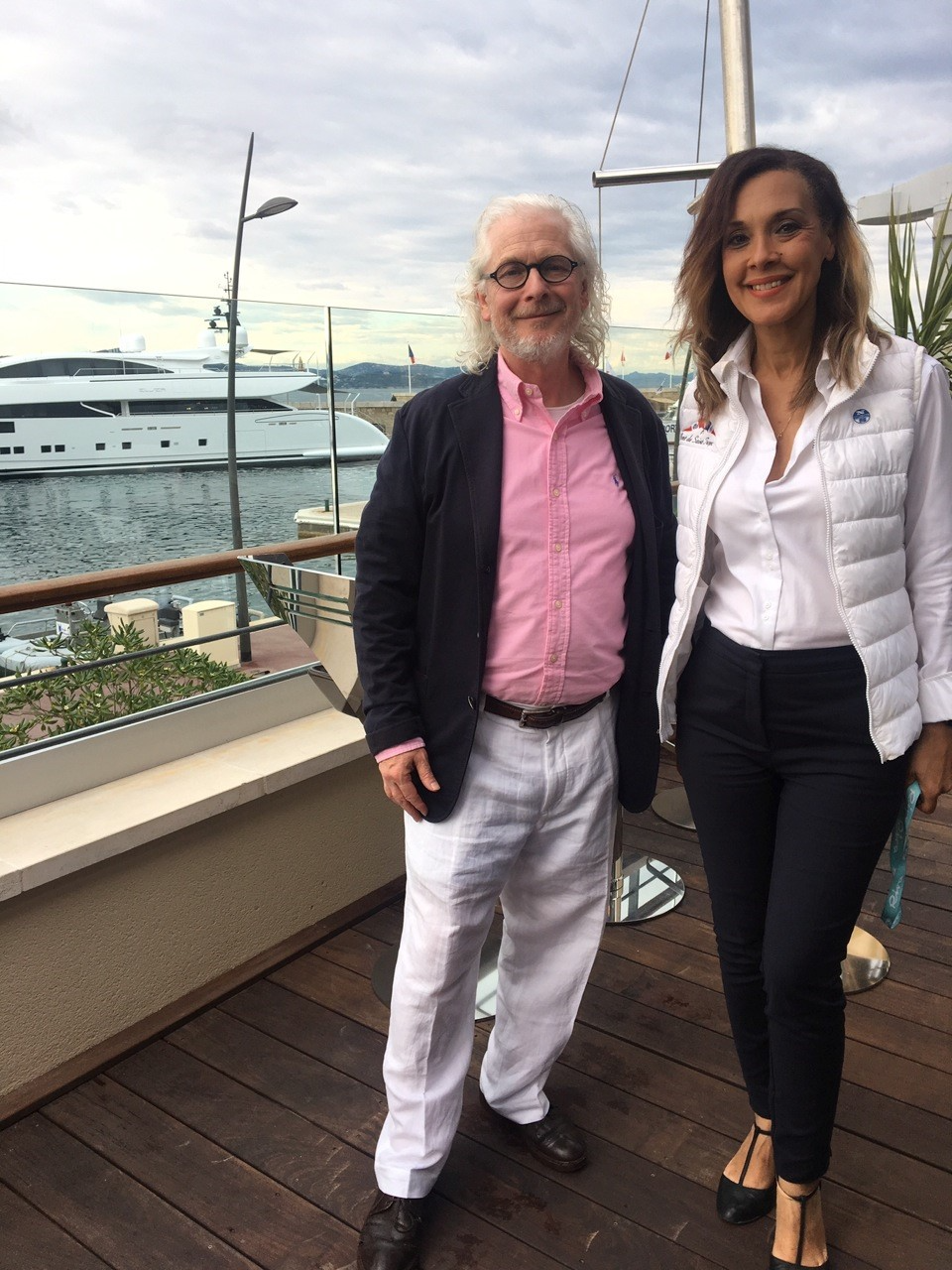 Anne-Marie Dandin, Head of Communications, Port de Saint-Tropez, with artist Peter Graham on the panoramic terrace balcony of the new Saint-Tropez Capitainerie Lounge Club
