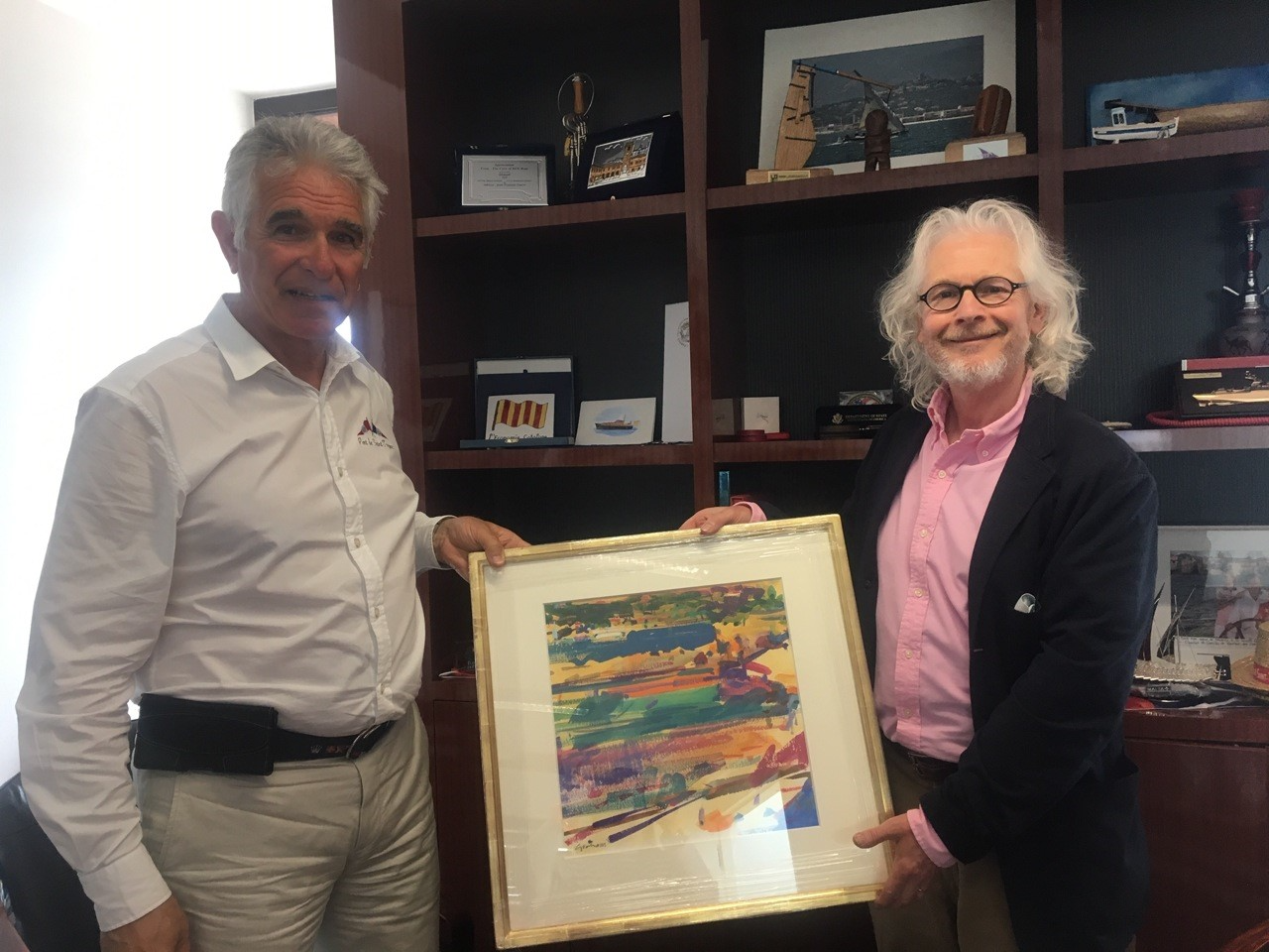 Monsieur Jean-François TOURRET Directeur du Port de Saint-Tropez with Peter Graham presenting his  painting 'Les Graniers'  in May this year