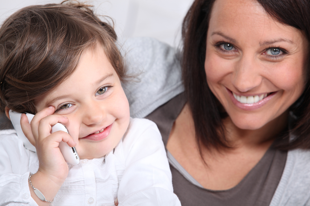 Preschooler talking on the phone with daddy or grandma