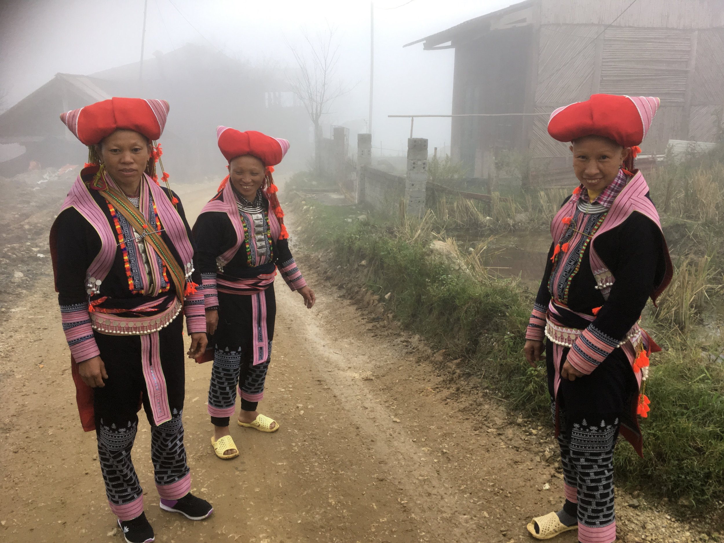 Meeting some local Red Zhou women along the trail