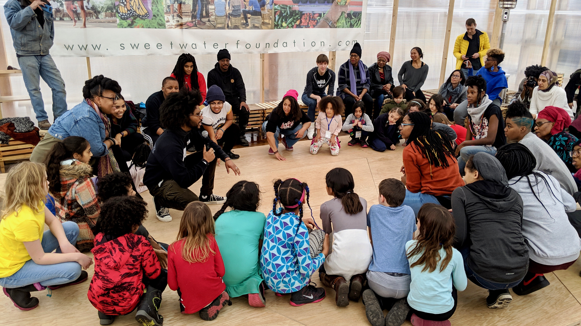 Urban Bush Women artists with Chicago Free School students in the Thought Barn at Sweet Water Foundation, from left: Du'Bois A'Keen, Love Muwwakkil, Cyrah Ward, and Chanon Judson. Photo by Zachary Whittenburg.