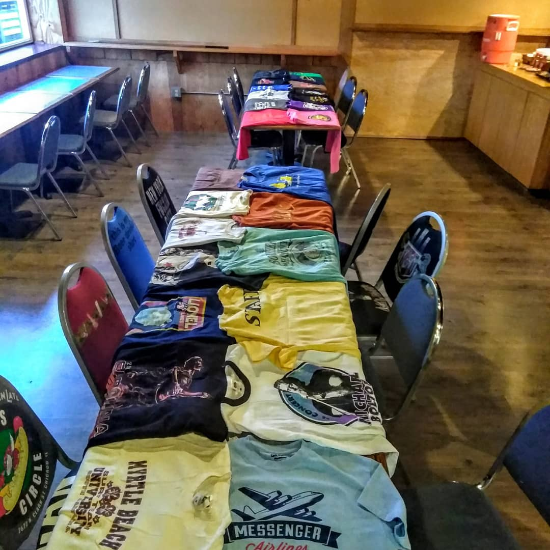 We re-upholstered our chairs with old t-shirts, this batch is from two boxes mom sent from North Carolina. Feel free to bring in yours and we will hang it on the wall for when the chairs are covered in bbq sauce!